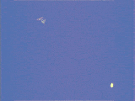 Image of the space station passing near Venus in the sky