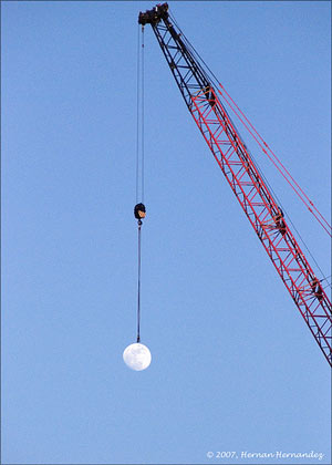 Picture of a crane hauling the Moon around